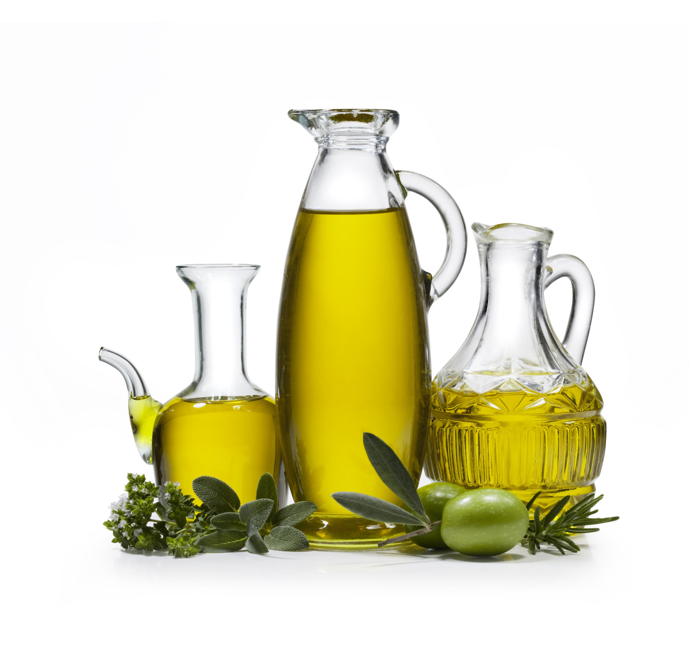 Three bottles of olive oil with two olives and spices on white background