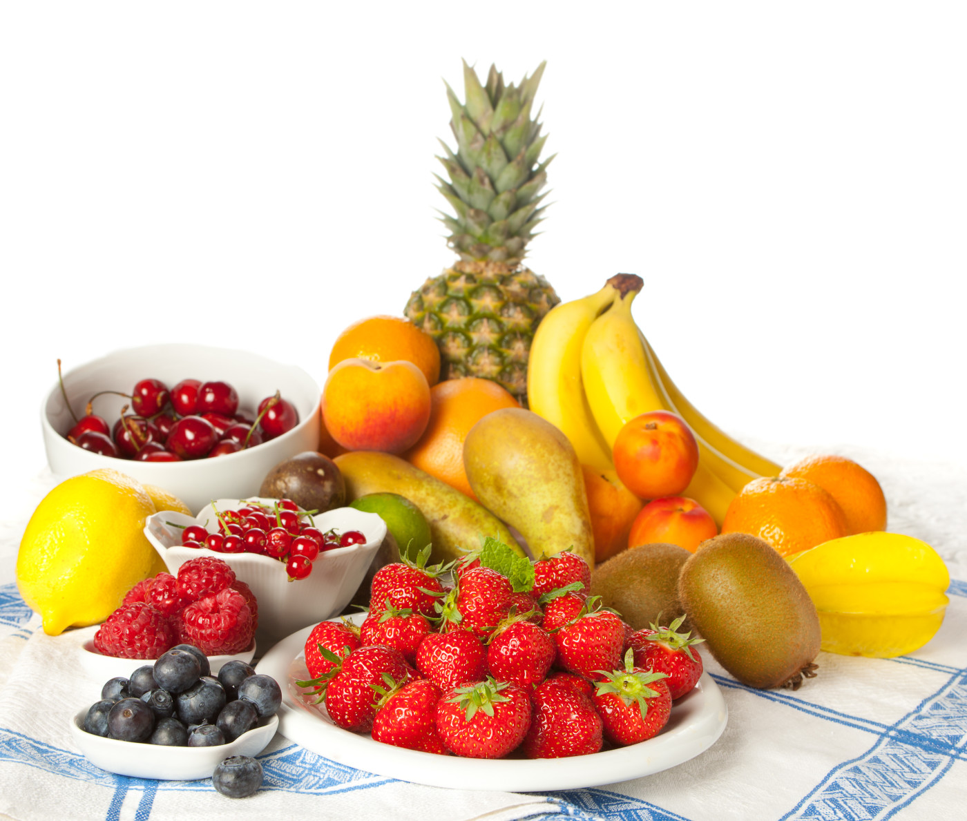 Assorted summer fruits on a vintage tablecloth