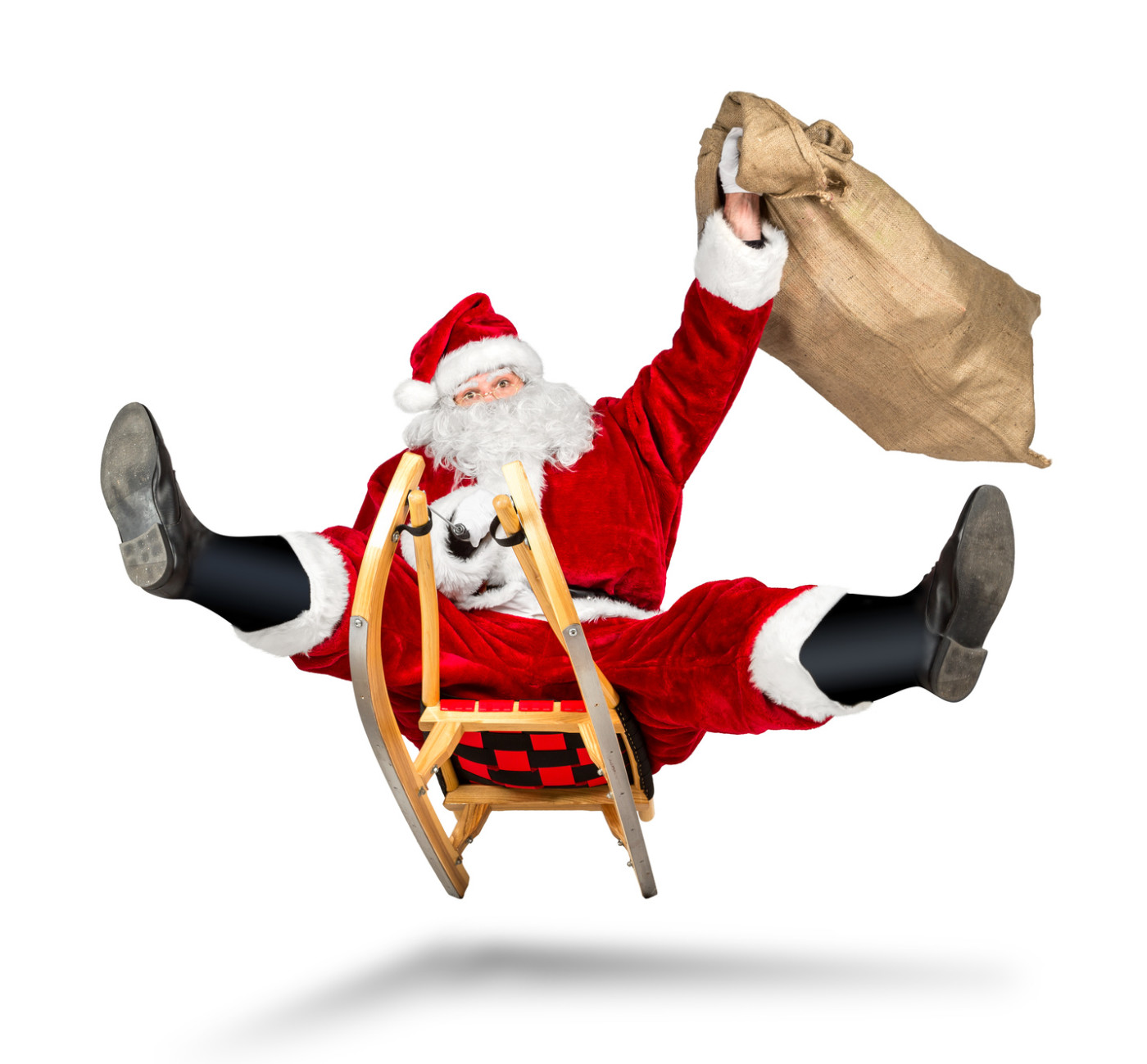 santa claus jumping on a sleigh crazy fast funny with his bag on christmas gift present delivery isolated / Weihnachtsmann rasant lustiug schnell auf Schlitten isoliert