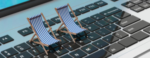 Summer at the office. Deck chairs on a computer laptop, banner. 3d illustration